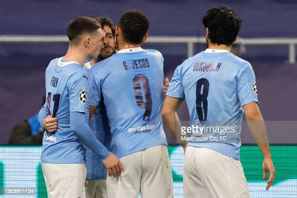 Bernardo Silva of Manchester City celebrates with team mates Phil Foden and Gabriel Jesus after scoring their side's first goal during the UEFA...