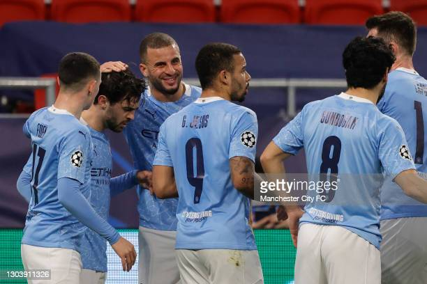 Bernardo Silva of Manchester City celebrates with team mates Phil Foden, Kyle Walker and Gabriel Jesus after scoring their side's first goal during...