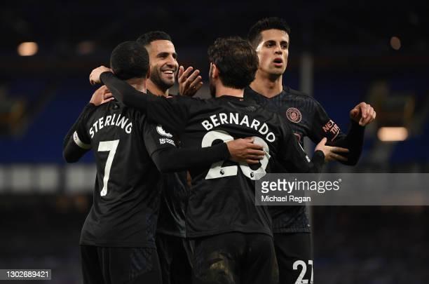Bernardo Silva of Manchester City celebrates with team mates Raheem Sterling, Riyad Mahrez, Joao Cancelo after scoring their side's third goal during...
