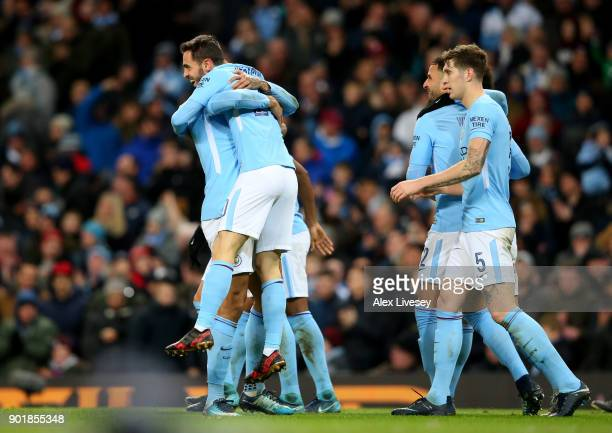 Bernardo Silva of Manchester City celebrates with teammate Danilo after scoring his sides fourth goal during The Emirates FA Cup Third Round match...