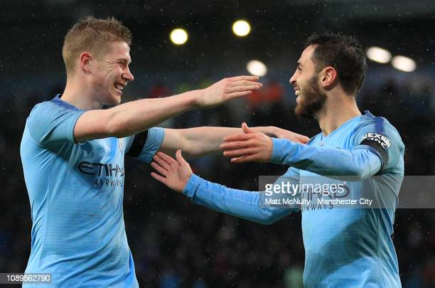 Bernardo Silva of Manchester City celebrates with teammate Kevin De Bruyne after scoring his team's second goal during the FA Cup Fourth Round match...