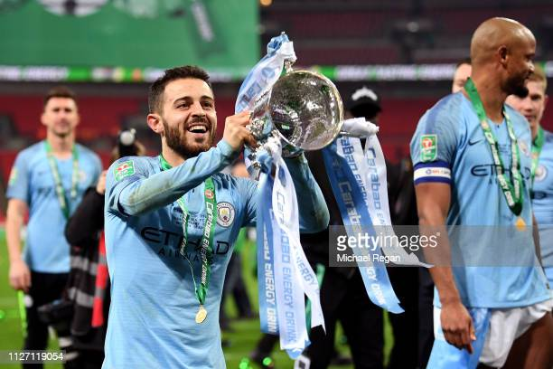 Bernardo Silva of Manchester City celebrates with the trophy after winning the Carabao Cup Final between Chelsea and Manchester City at Wembley...