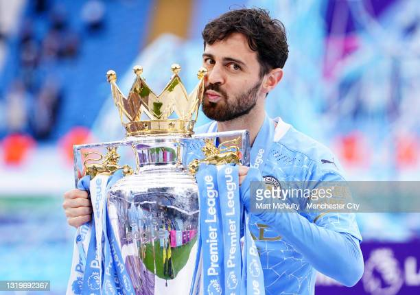 Bernardo Silva of Manchester City celebrates with the trophy during the Premier League match between Manchester City and Everton at Etihad Stadium on...