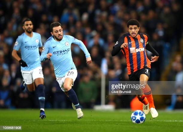 Bernardo Silva of Manchester City chases the ball as Taison of Shakhtar Donetsk controls the ball during the Group F match of the UEFA Champions...