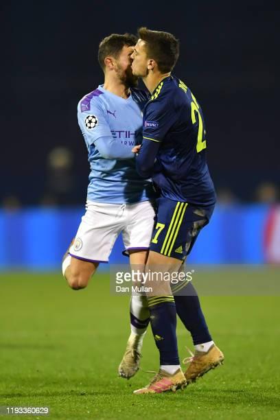 Bernardo Silva of Manchester City clashes with Nikola Moro of GNK Dinamo Zagreb during the UEFA Champions League group C match between Dinamo Zagreb...