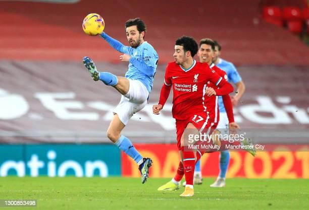 Bernardo Silva of Manchester City controls the ball under pressure from Curtis Jones of Liverpool during the Premier League match between Liverpool...