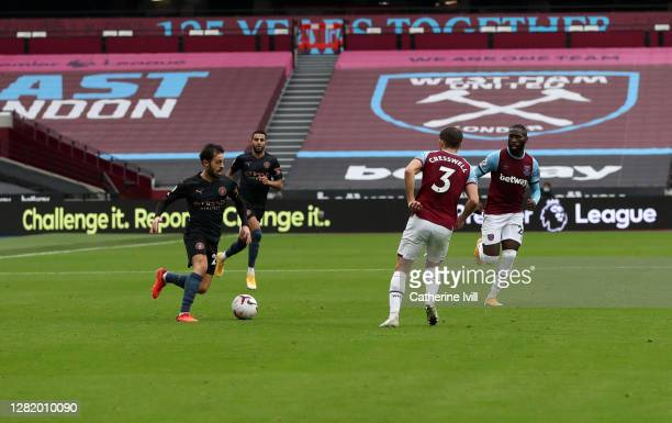 Bernardo Silva of Manchester City in action infront of advertising boards read the 'no room for racism' during the Premier League match between West...