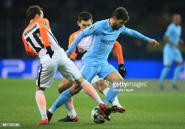 Bernardo Silva of Manchester City is challenged by Bernard of Shakhtar Donetsk during the UEFA Champions League group F match between Shakhtar...