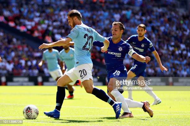 Bernardo Silva of Manchester City is challenged by Cesar Azpilicueta of Chelsea during the FA Community Shield match between Manchester City and...