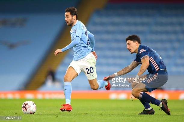 Bernardo Silva of Manchester City is challenged by Hector Bellerin of Arsenal during the Premier League match between Manchester City and Arsenal at...