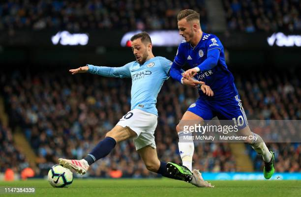 Bernardo Silva of Manchester City is challenged by James Maddison of Leicester City during the Premier League match between Manchester City and...