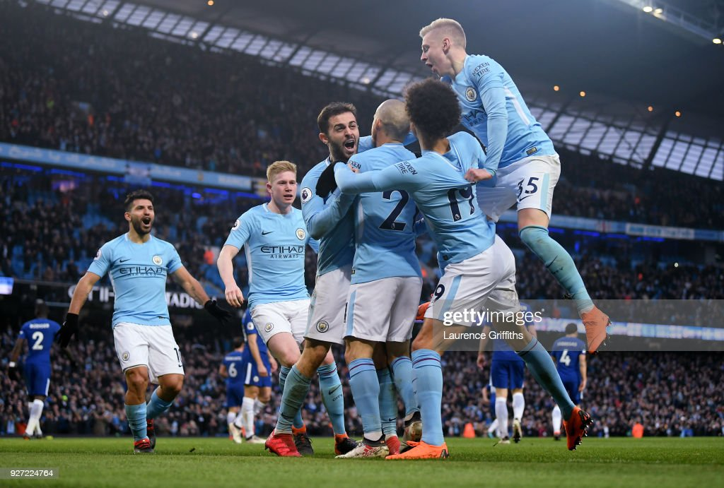Bernardo Silva of Manchester City is congratulated after scoring the opening goal during the Premier League match between Manchester City and Chelsea at Etihad Stadium on March 4, 2018 in Manchester, England.