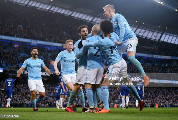 Bernardo Silva of Manchester City is congratulated after scoring the opening goal during the Premier League match between Manchester City and Chelsea...