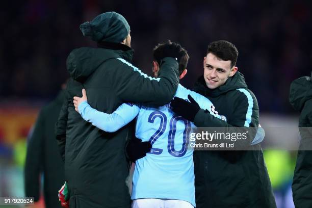 Bernardo Silva of Manchester City is hugged by teammate Phil Foden after the UEFA Champions League Round of 16 First Leg match between FC Basel and...