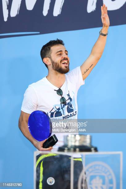 Bernardo Silva of Manchester City is rewarded player of the season during the Manchester City trophy parade in Manchester on May 20 2019 in...