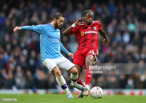 Bernardo Silva of Manchester City is tackled by Terence Kongolo of Fulham during the FA Cup Fourth Round match between Manchester City and Fulham at...