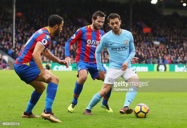 Bernardo Silva of Manchester City is watched by Andros Townsend and Yohan Cabaye of Crystal Palace during the Premier League match between Crystal...