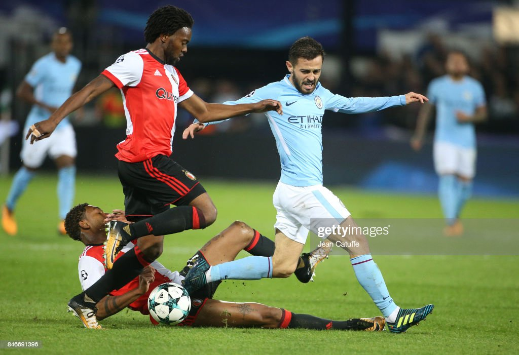 Bernardo Silva of Manchester City, Miquel Nelom and Jean-Paul Boetius of Feyenoord (left) during the UEFA Champions League match between Feyenoord Rotterdam and Manchester City at Stadion Feijenoord on September 13, 2017 in Rotterdam, Netherlands.