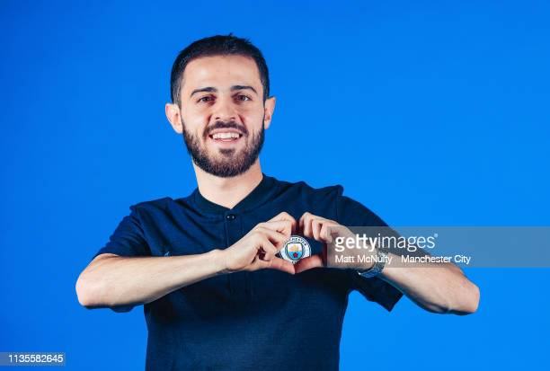 Bernardo Silva of Manchester City poses for a portrait after signing a contract extension at Manchester City Football Academy on March 13 2019 in...