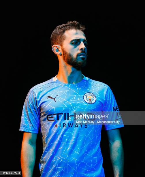 Bernardo Silva of Manchester City poses wearing the 2020/21 Puma home jersey at the City Football Academy on August 03, 2020 in Manchester, England.