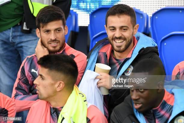 Bernardo Silva of Manchester City reacts on the bench with David Silva of Manchester City during the Premier League match between Everton FC and...