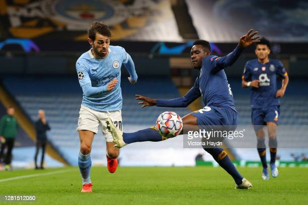 Bernardo Silva of Manchester City runs with the ball past Zaidu of FC Porto during the UEFA Champions League Group C stage match between Manchester...