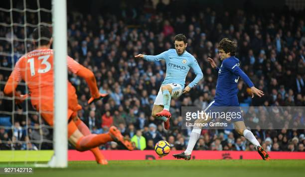 Bernardo Silva of Manchester City scores his side's first goal during the Premier League match between Manchester City and Chelsea at Etihad Stadium...