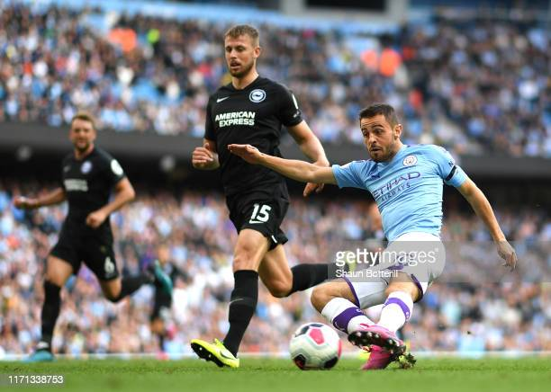 Bernardo Silva of Manchester City scores his team's fourth goal during the Premier League match between Manchester City and Brighton Hove Albion at...