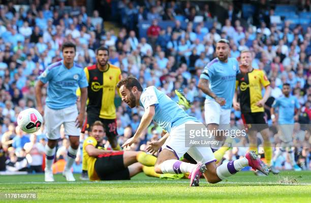 Bernardo Silva of Manchester City scores his team's fourth goal during the Premier League match between Manchester City and Watford FC at Etihad...