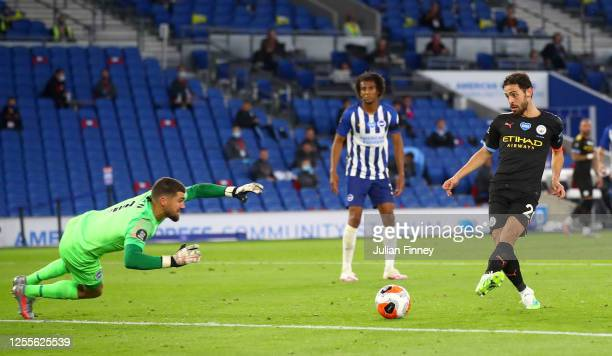 Bernardo Silva of Manchester City scores his team's fourth goal during the Premier League match between Brighton & Hove Albion and Manchester City at...