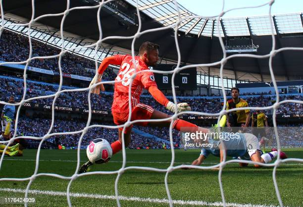 Bernardo Silva of Manchester City scores his team's fourth goal past Ben Foster of Watford FC during the Premier League match between Manchester City...