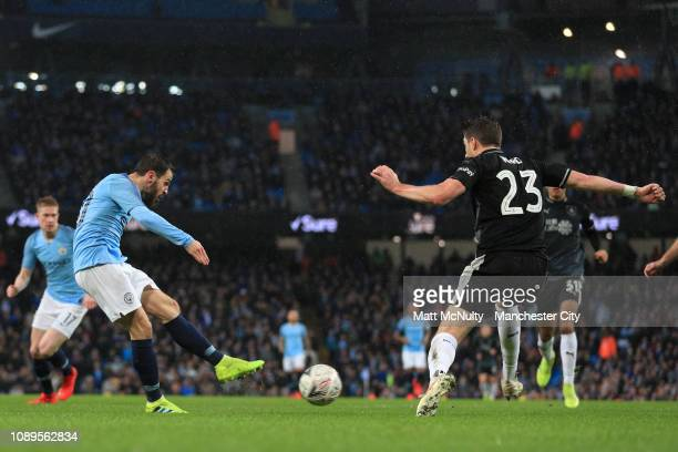 Bernardo Silva of Manchester City scores his team's second goal during the FA Cup Fourth Round match between Manchester City and Burnley at Etihad...