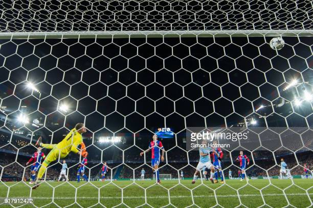 Bernardo Silva of Manchester City scores his team's second goal past goalkeeper Tomas Vaclik of Basel during the UEFA Champions League Round of 16...