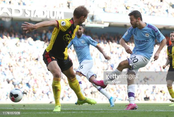 Bernardo Silva of Manchester City scores his team's sixth goal during the Premier League match between Manchester City and Watford FC at Etihad...