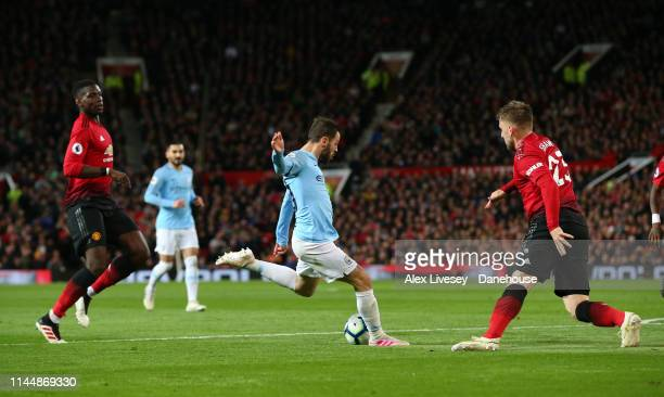 Bernardo Silva of Manchester City scores the opening goal during the Premier League match between Manchester United and Manchester City at Old...