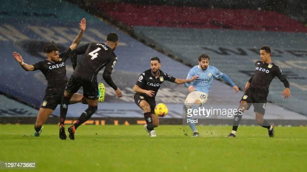 Bernardo Silva of Manchester City scores their side's first goal during the Premier League match between Manchester City and Aston Villa at Etihad...