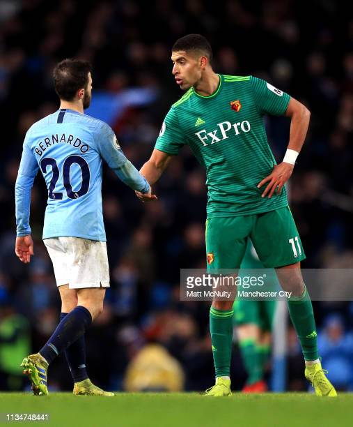 Bernardo Silva of Manchester City shakes hands with Adam Masina of Watford during the Premier League match between Manchester City and Watford FC at...