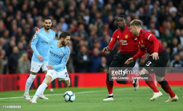 Bernardo Silva of Manchester City takes on Luke Shaw and Paul Pogba of Manchester United during the Premier League match between Manchester United...