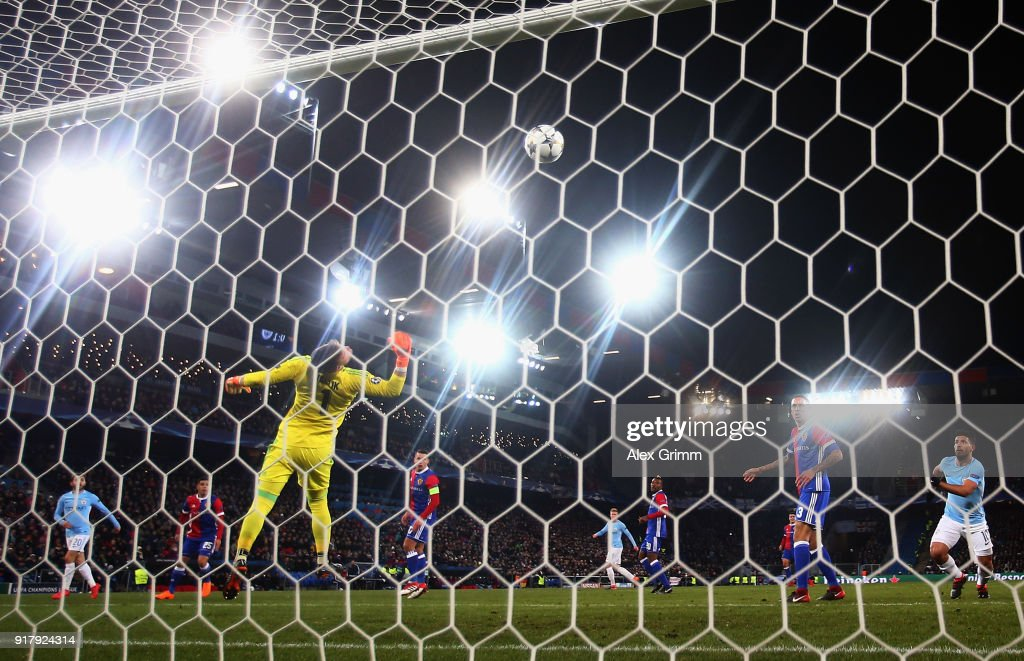 Bernardo Silva (L) of Manchester scores his team's second goal past goalkeeper Tomas Vaclik of Basel during the UEFA Champions League Round of 16 First Leg match between FC Basel and Manchester City at St. Jakob-Park on February 13, 2018 in Basel, Switzerland.