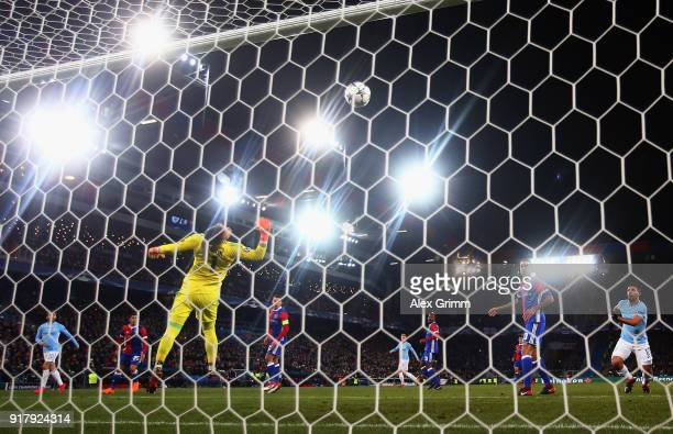 Bernardo Silva of Manchester scores his team's second goal past goalkeeper Tomas Vaclik of Basel during the UEFA Champions League Round of 16 First...