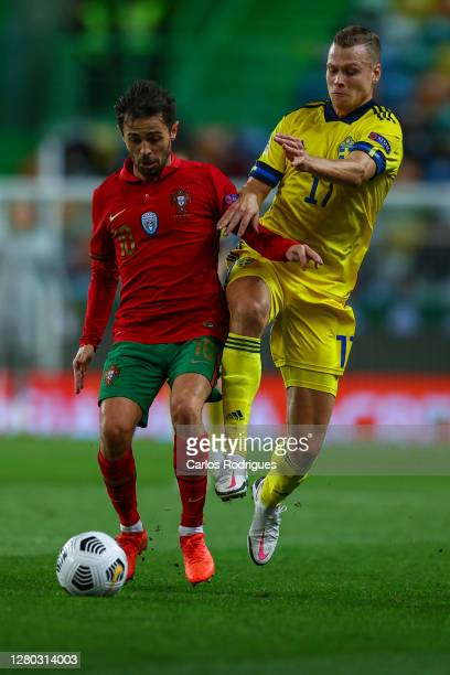 Bernardo Silva of Portugal and Machester City FC vies with Viktor Claesson of Sweden and FK Krasnodar for the ball possession during the UEFA Nations...