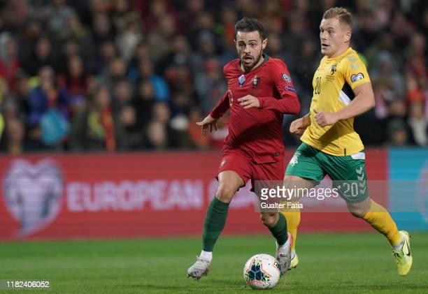 Bernardo Silva of Portugal and Manchester City with Domantas Simkus of Lithuania in action during the UEFA Euro 2020 Qualifier match between Portugal...