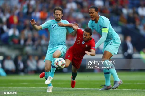 Bernardo Silva of Portugal battles for possession with Daley Blind and Virgil van Dijk of the Netherlands during the UEFA Nations League Final...