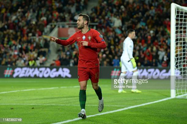 Bernardo Silva of Portugal celebrates after scores the fifth goal against Lithuania during the UEFA Euro 2020 Qualifier match between Portugal and...
