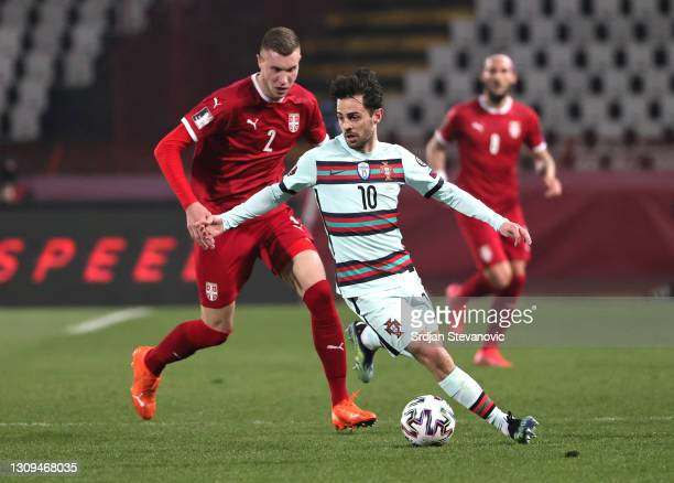 Bernardo Silva of Portugal is put under pressure by Strahinja Pavlovic of Serbia battle for the ball during the FIFA World Cup 2022 Qatar qualifying...