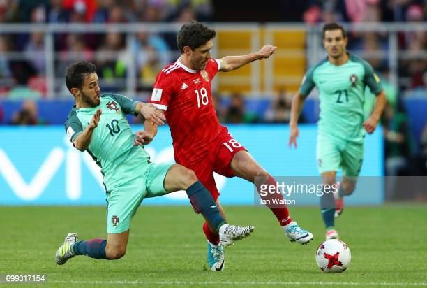 Bernardo Silva of Portugal tackles Yury Zhirkov of Russia during the FIFA Confederations Cup Russia 2017 Group A match between Russia and Portugal at...