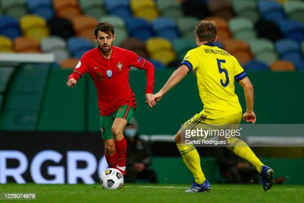 Bernardo Silva of Portugal tries to pass trough Pierre Bengtsson of Sweden during the UEFA Nations League group stage match between Portugal and...