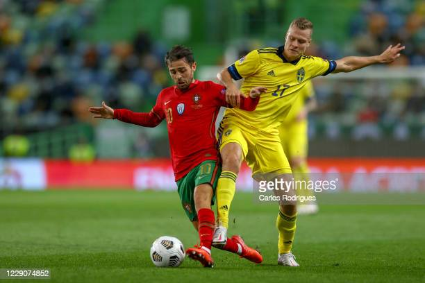 Bernardo Silva of Portugal vies with Viktor Claesson of Sweden for the ball possession during the UEFA Nations League group stage match between...