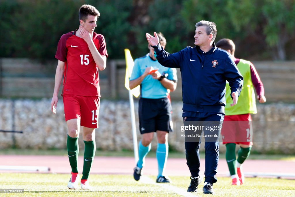 Bernardo Silva (L) receives instructions by Rui Bento, Head Coach of Portugal U17 during U17-Juniors Algarve Cup match between U17 Portugal and U17 Germany at Bela Vista Stadium on February 13, 2018 in Parchal, Portugal.