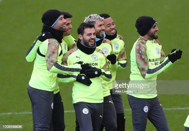 Bernardo Silva Riyad Mahrez Gabriel Jesus and Sergio Aguero of Manchester City share a joke during a training session ahead of their UEFA Champions...